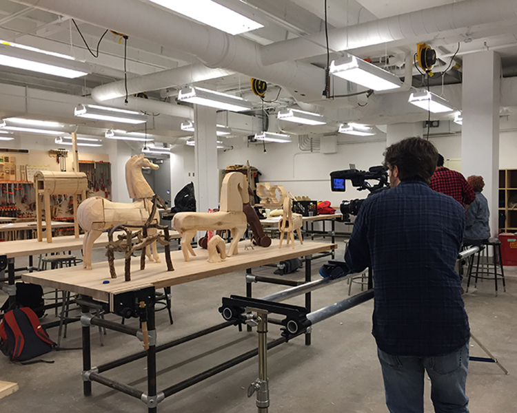 Yari filming the test models made by students in the MassArt Trojan Horse class.