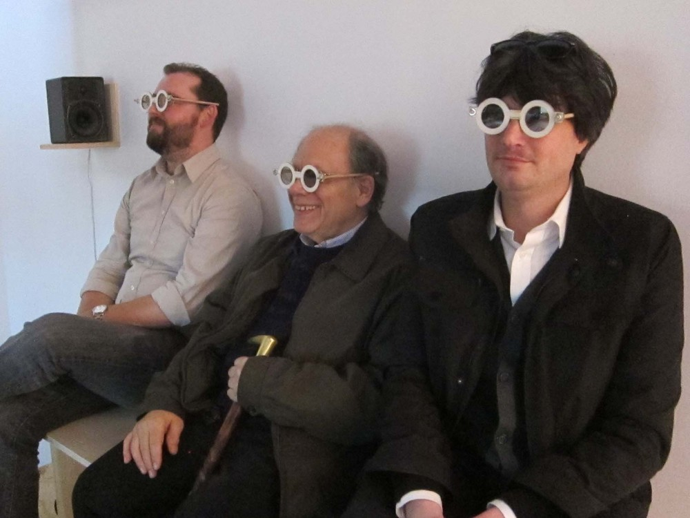 Viewers donned special wooden glasses with polarized lens to watch Brent Green's new work  To Many Men Strange Fates are Given  on exhibit at Stephen Wolf Fine Arts as part of the Film Society's KinoTek series. From left Bill Proctor (SFFS), Karl Cohen (ASIFA-SF) and Keith Cowling (SFFS).  Photo by Hilary Hart.