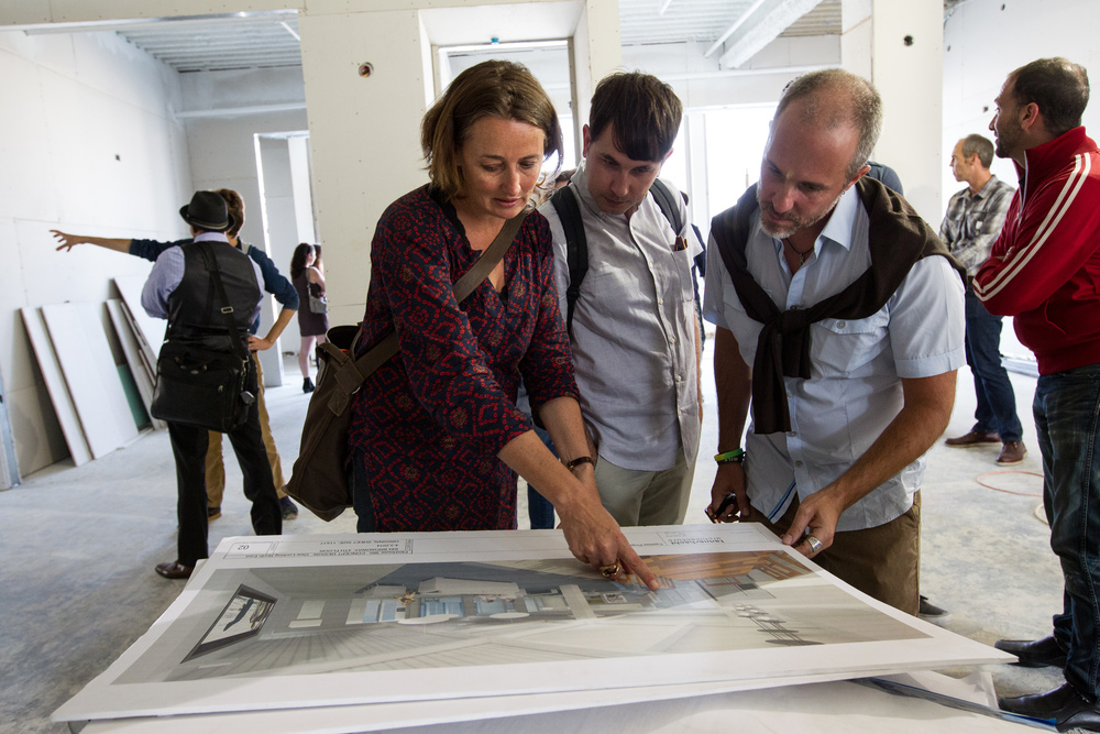 Director of Filmmaker360 Michele Turnure-Salleo reviews renderings of the new FilmHouse. Photo by Erin Lubin.