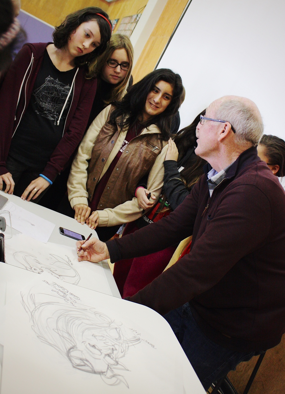 Keane speaking with students one-on-one after his live drawing demonstration. Photo by Keith Zwölfer.