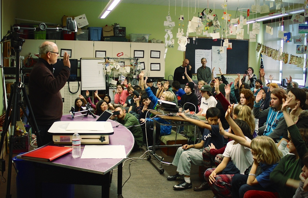Animator Glen Keane quizzing local students. Photo by Julie Stallone.