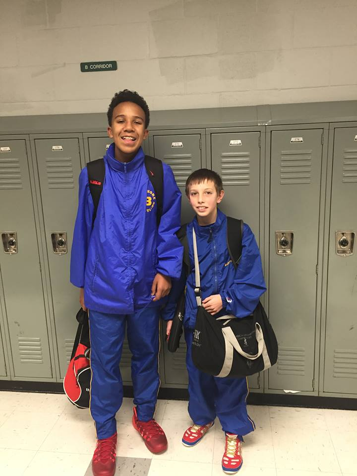My 12 year old baby brother towering over one of his teammates of the same age.