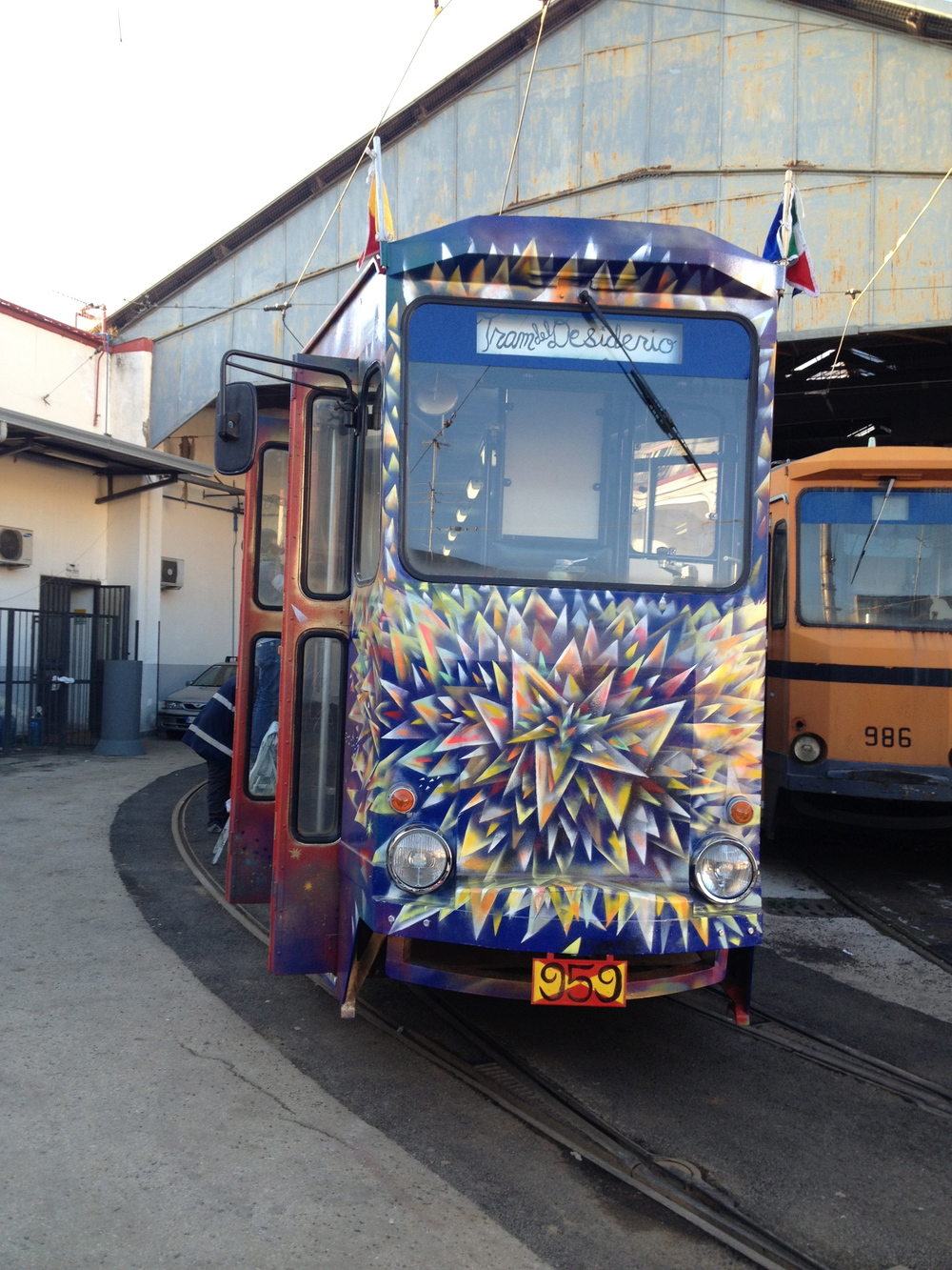 Il Rinascimento Cosmico (The Cosmic Renaissance): city tram painted by Jade Fusco and Nicolina Johnson, sponsored by the city of Naples, Italy (2013)