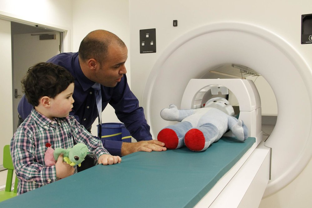 Professor Adam Guatella shows a participant our practice MRI scanner, one of our specialised research facilities