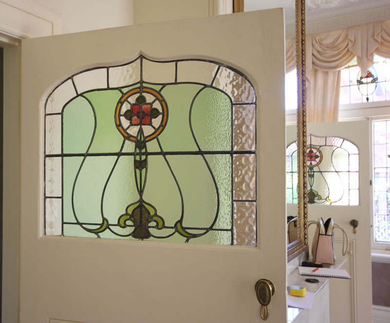 Before : detail of the incredible doors and their Art Nouveau lead light.