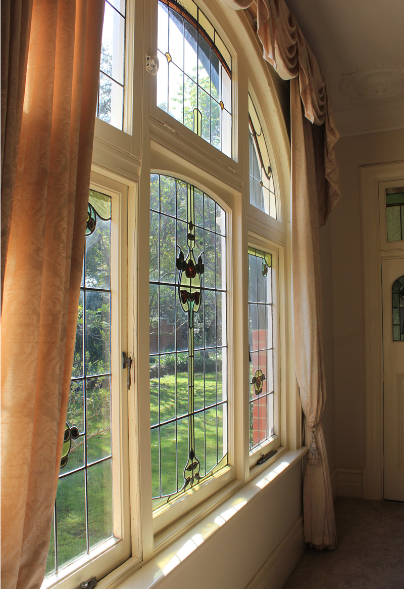Incredibly beautiful lead light windows in Art Nouveau patterns set the tone for the entire renovation of this once-glorious house.