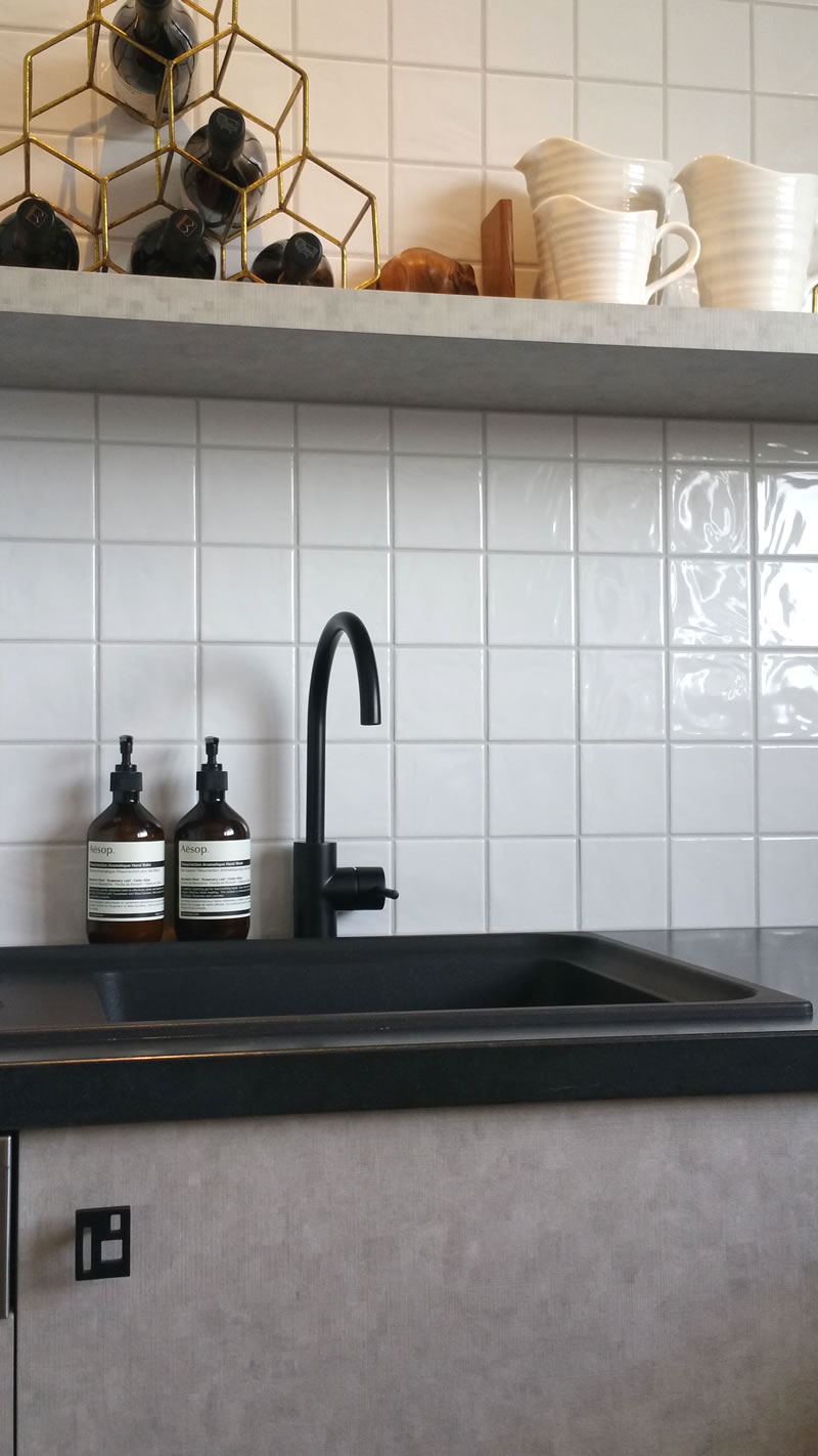 The kitchen uses the same materials as the bathroom, but the handles are quite different. They are also hand-made, but in a very matte black iron finish, in a style which references the Bessa Block work of the apartment building balconies.  Australian-made Brodware matt black mixer.