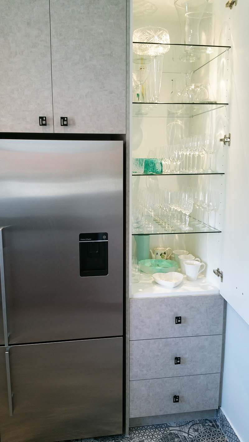 Glass shelves, with in-built cabinet LED lighting, are a marvellous way to house crystal and glass, because it's quick to find what you are looking for. The pull out deep drawers below house that fabulous collection of china I mentioned.