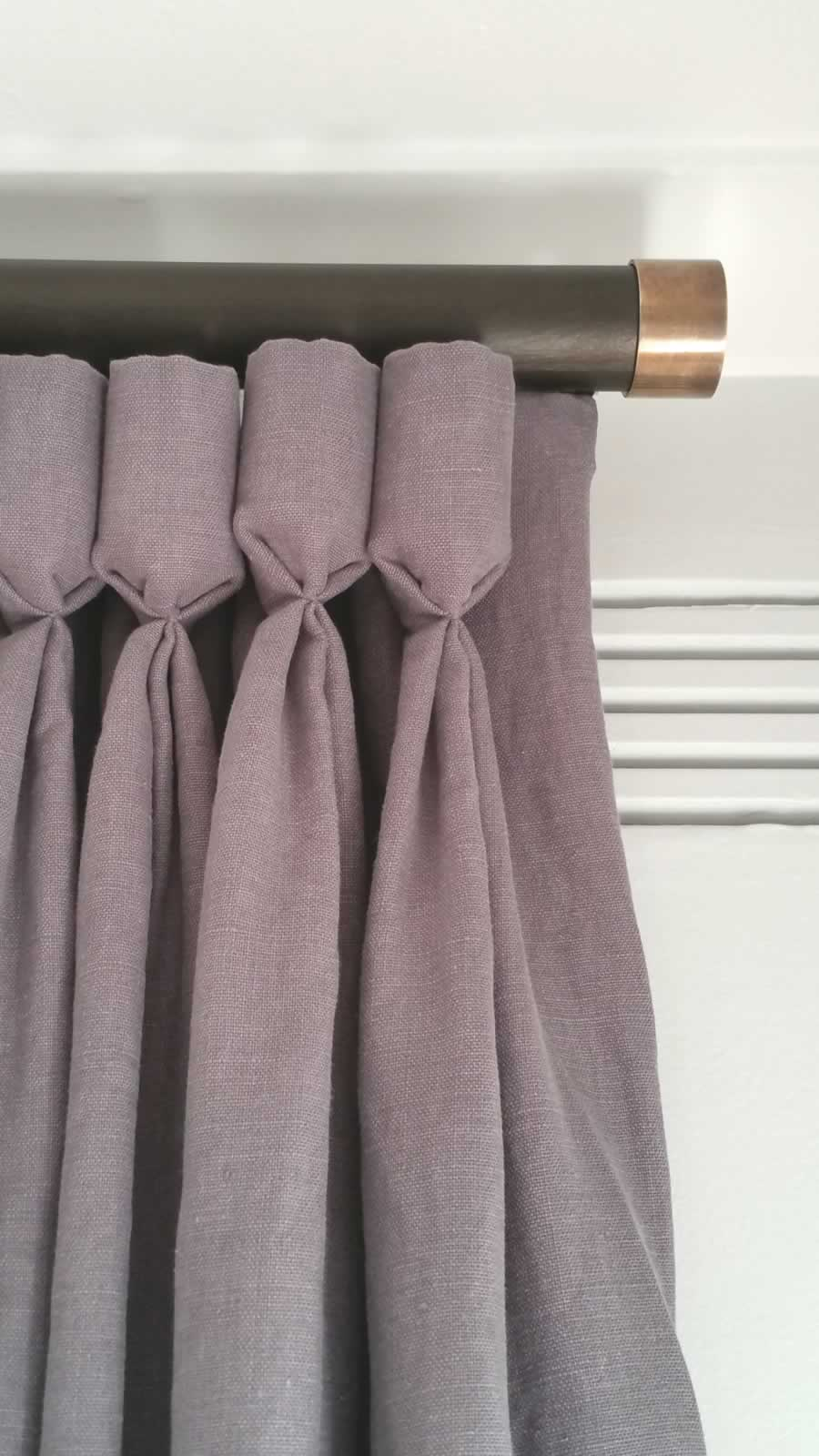 Curtains in the living room are made from very textured Spanish linen, with an unusual Goblet Pleat heading.