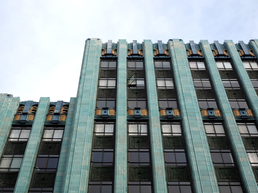 Various motifs adorn the facade, including chevrons, zigzag & sunbursts, as well as very stylised animal and plant forms, in the fashion of the day. The building was converted to apartments in 2006.