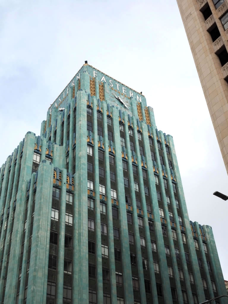 The Eastern Columbia Building was built in 9 months, and opened in 1930. The facade is clad in glossy turquoise terracotta tile, trimmed with blue and gold glazed terracotta tile. It was the HQ of the Eastern Outfitting Company and Columbia Outfitting Company (clothing & furniture stores).