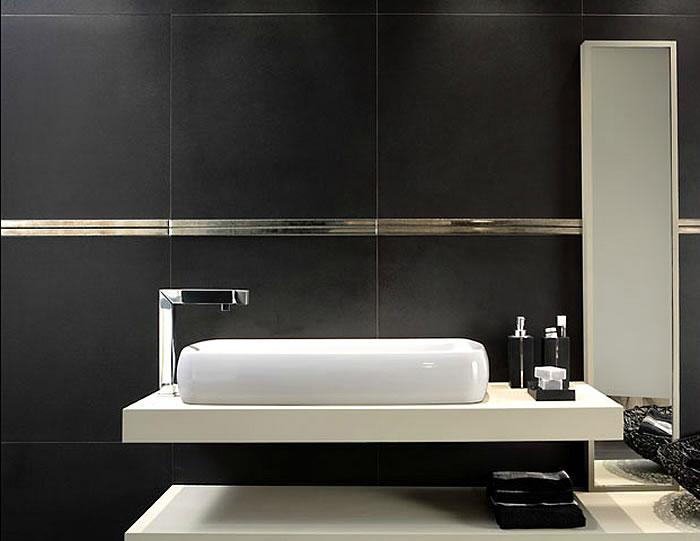 3a6a1-signorinotilerichmondbalckgoldbathroom.jpg