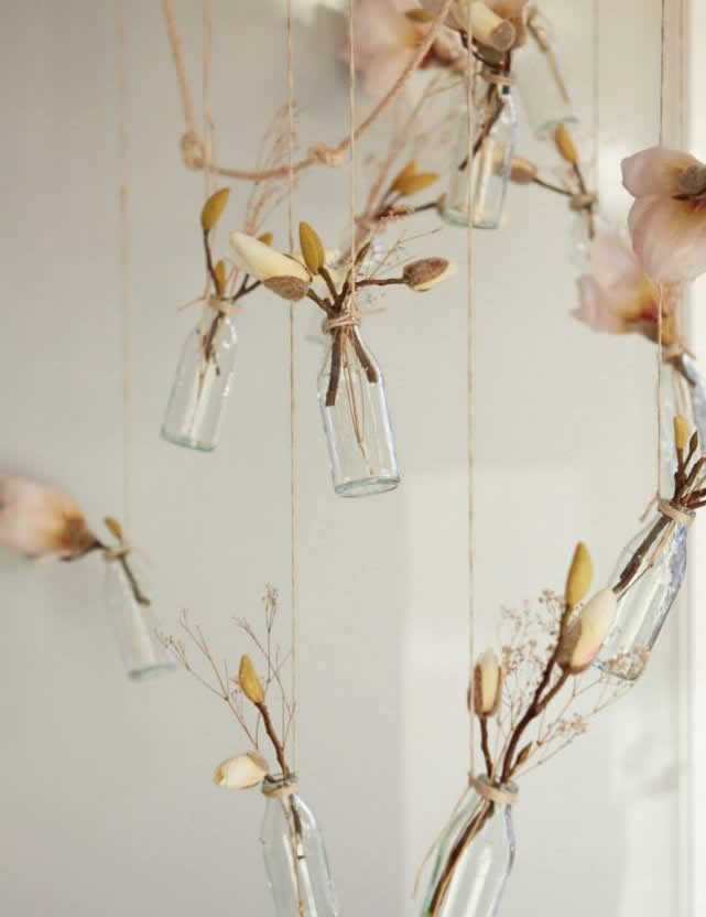 anna campbell gossamer collection magnolia flowers in hanging bottles
