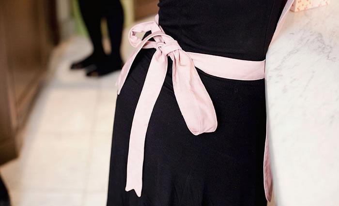 pale pink sash against black dress via park and cube