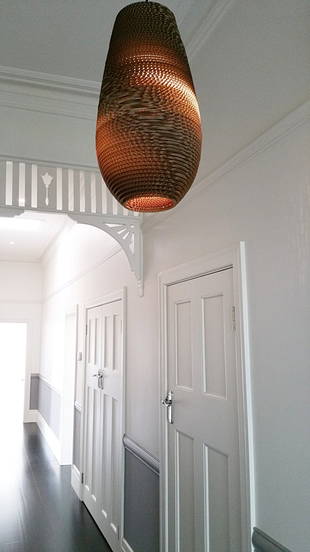 Dramatic lighting - New contemporary style LED lightingwas installed throughout the home,to contrast with traditional detailslike the original timber fretwork & ceiling roses.