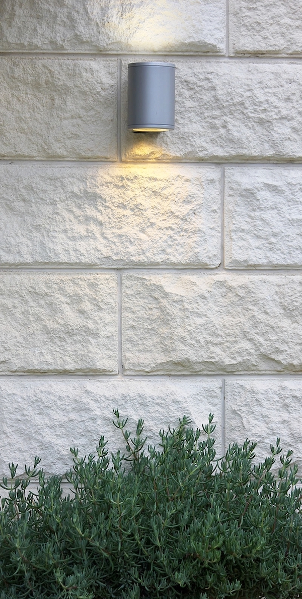 mt gambier limestone - This ancient stone, formed by fossilised layers of seashells millions of years ago when the sea bed was in what is now land, has a creamy colouring which almost glows.The split-face form is especially playful with light, casting undulating pools of light & shade across its form.