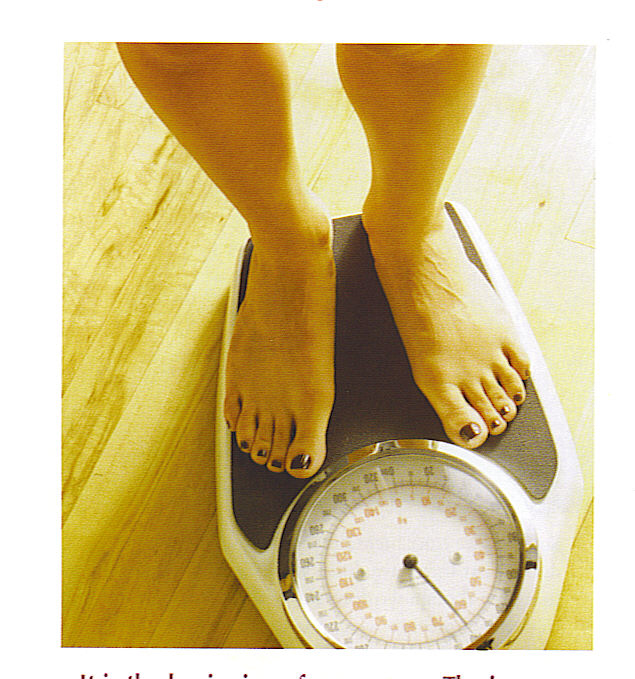 Woman weighing herself.jpg