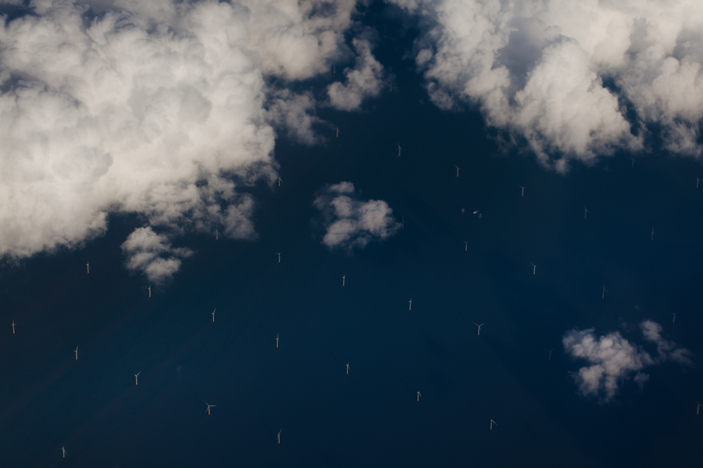 windmills in the sea. flying back from belgium to new york.