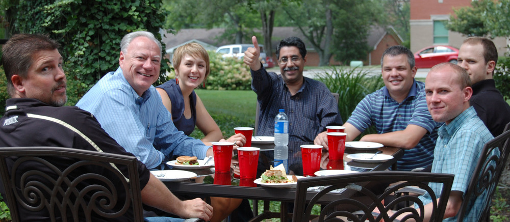 A few of CE Solutions' team members enjoying lunch on the patio.