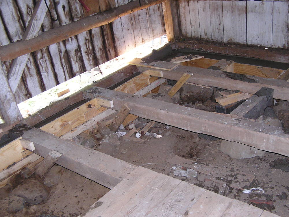 Here rotted joists have been replaced with vintage timbers that are sound.