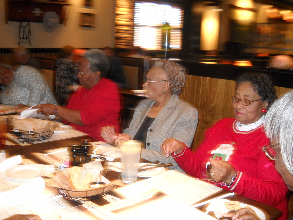 Priscilla (second from left) sharing a holiday meal with the ladies of Southern Journeys