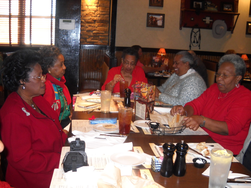 Alice (second from left) enjoying a holiday meal with Southern Journeys