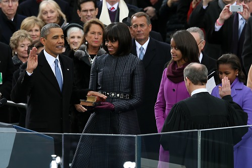 President Obama swearing on MLK's Bible as he takes the inaugural oath