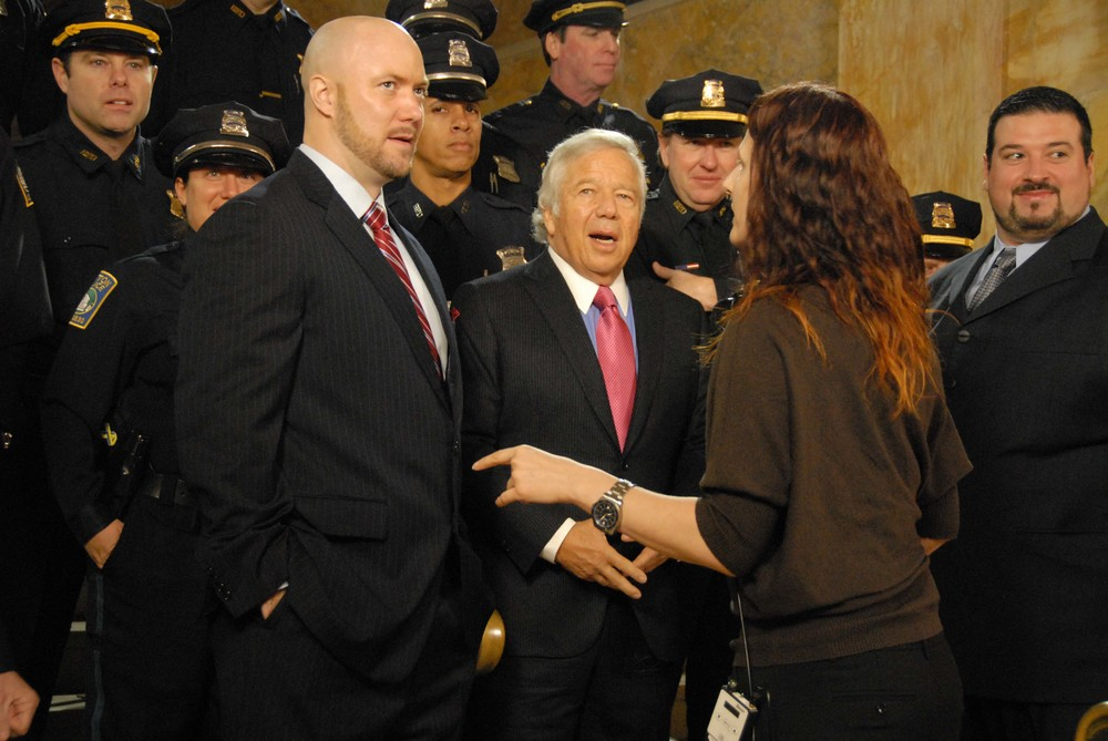 FORMER PATRIOT MATT CHATMAN, ROBERT KRAFT AND FORMER PATRIOT JOE ANDRUZZI AT THE BOSTON PUBLIC LIBRARY TAPING A SEGMENT TO BE AIRED DURING THE SUPER BOWL.