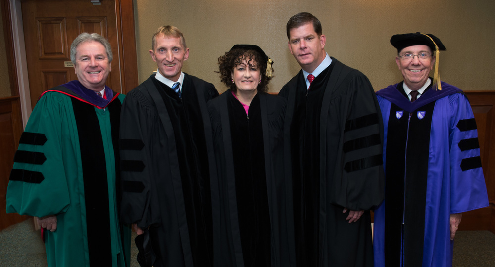 From left to right: Dean John F. O'Brien; Boston Police Commissioner William B. Evans; Lyndia Downie, president and executive director of the Pine Street Inn; Mayor Martin J. Walsh; and Martin C. Foster, chairman of the law school's board of trustees.