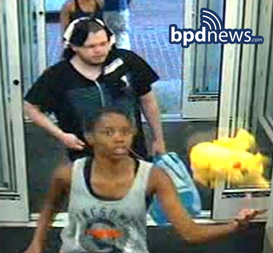 Person of Interest #3: Black female wearing a gray tank top.