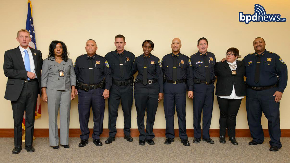 Pictured left to right: Commissioner Evans, Det. Cothenia Cooper, Sgt. John Teixeira, Sgt. Garrett Mitchell, Sgt. Sharon Dottin, Lt. Marwan Moss, Lt. Michael McCarthy, Det. Lucia Palomares, Chief William Gross