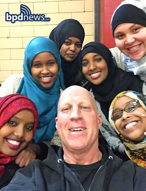BPD Superintendent Robert Merner poses for a selfie with kids from the Somali Community & Cultural Association