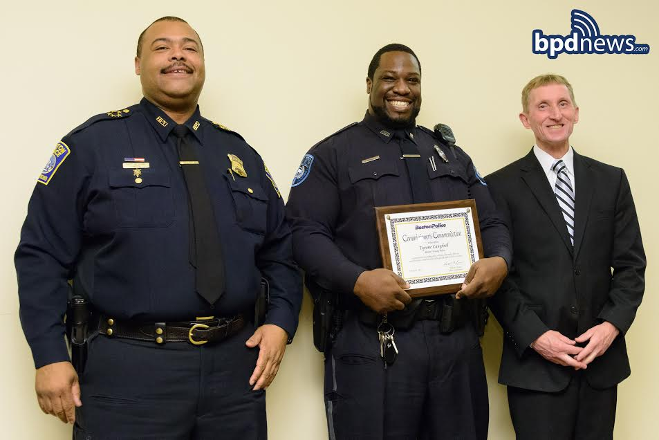Officer Tyrone Campbell poses with Chief Gross and Commissioner Evans.