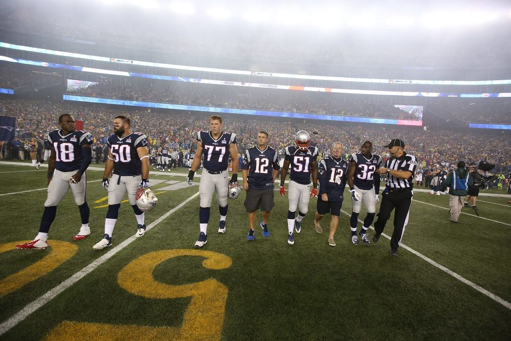 Officer Moynihan wearing #12 center - photo courtesy of the New England Patriots
