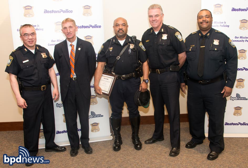 Officer Michael Forde Pictured Center