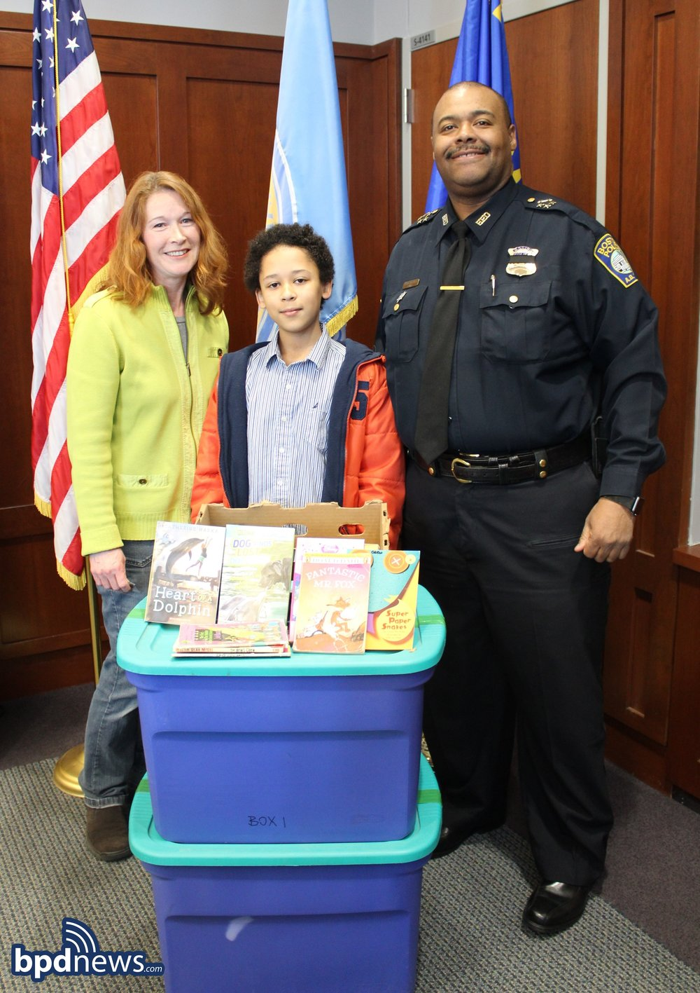 Henry with his Mom and Chief Gross, who accepted the books on behalf of the BPD