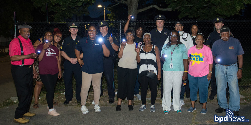 BPD in the Community: Bright Lights and Big Smiles on Full Display at the District C-11 Flashlight Walk in Dorchester