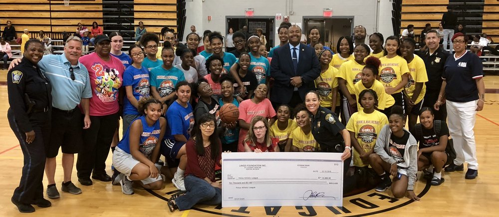 BPD in the Community: Police Athletics League Gifted $10,000 Donation from the Lingzi Foundation