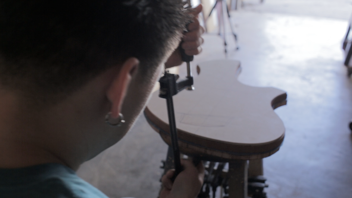 Production still from upcoming video - Perry Working on Custom Unga Guitar