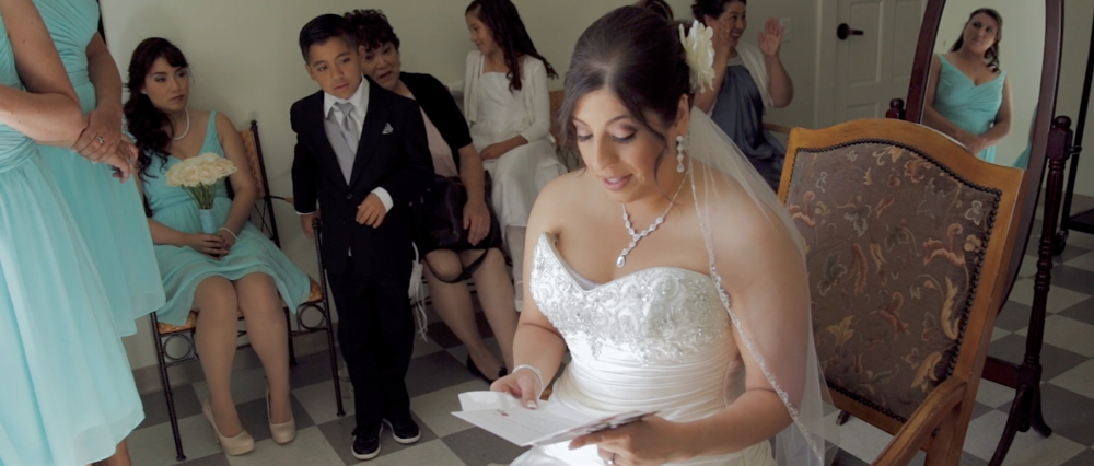 Atheha as she is reading a beautiful letter from her soon to be Husband Tim. The Photo was taken moments before Athena was about to get married.