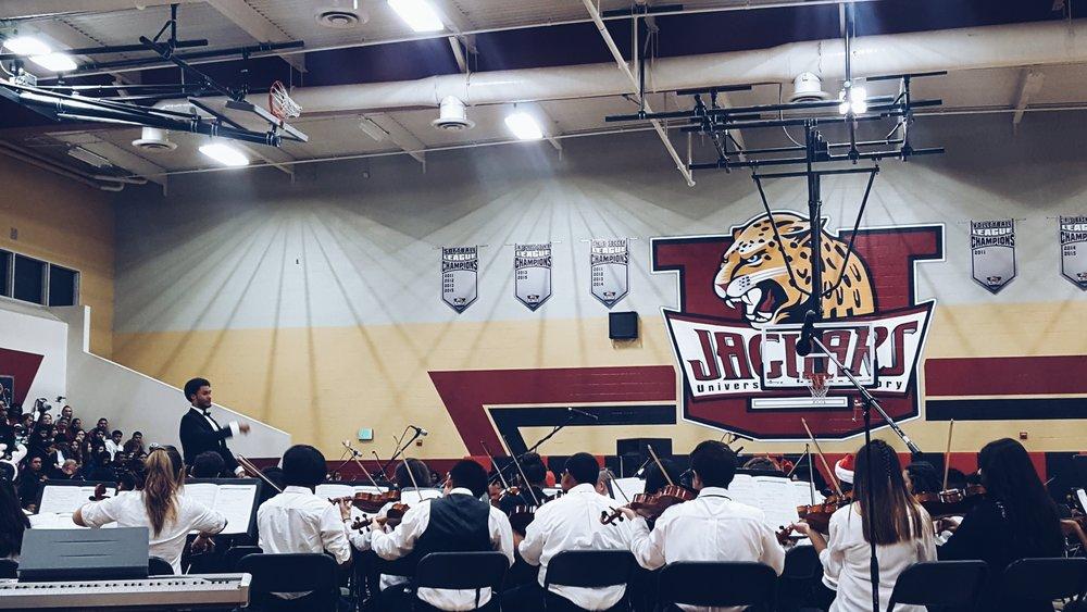 Matt O'rane conduction University Prep. Orchestra