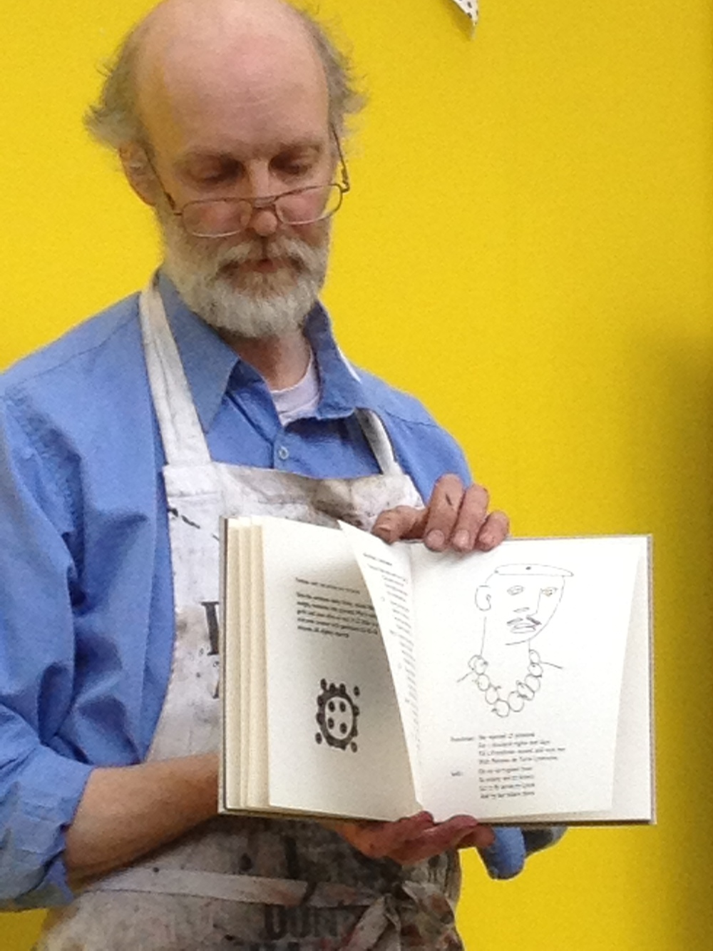 Richard Lawrence with an Artists book he printed