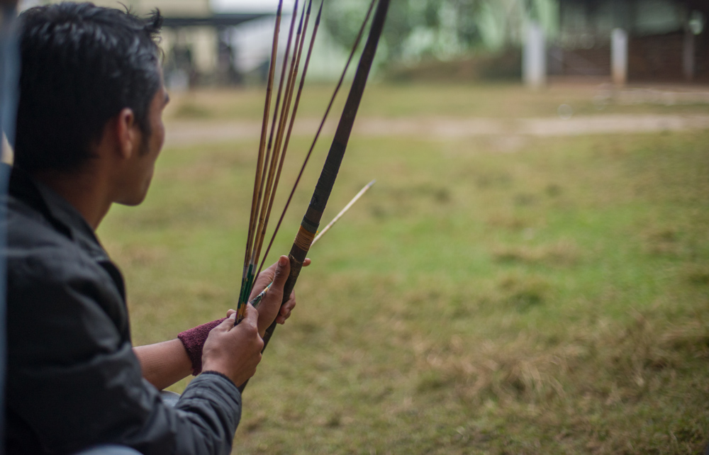 An archer lines up, ready to fire in to the target.