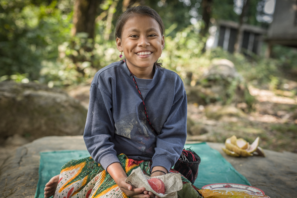 A young Khasi girl selling fruit to the occasional visitors to the living root bridge. Ever smiling and good natured, you will be pleased to do business with her.