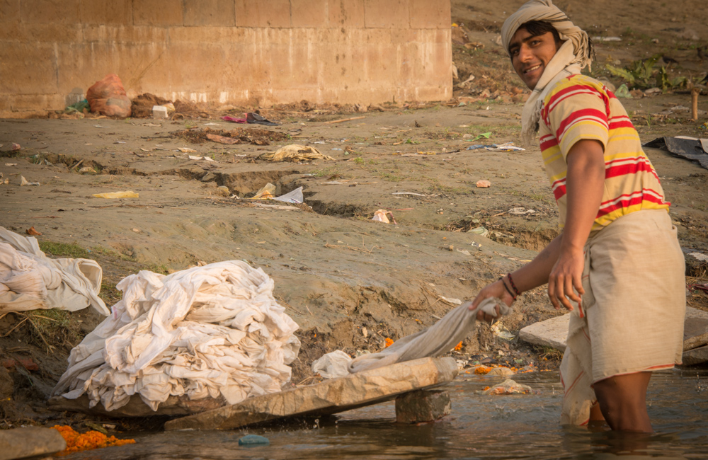 Man washing clothes in ganges