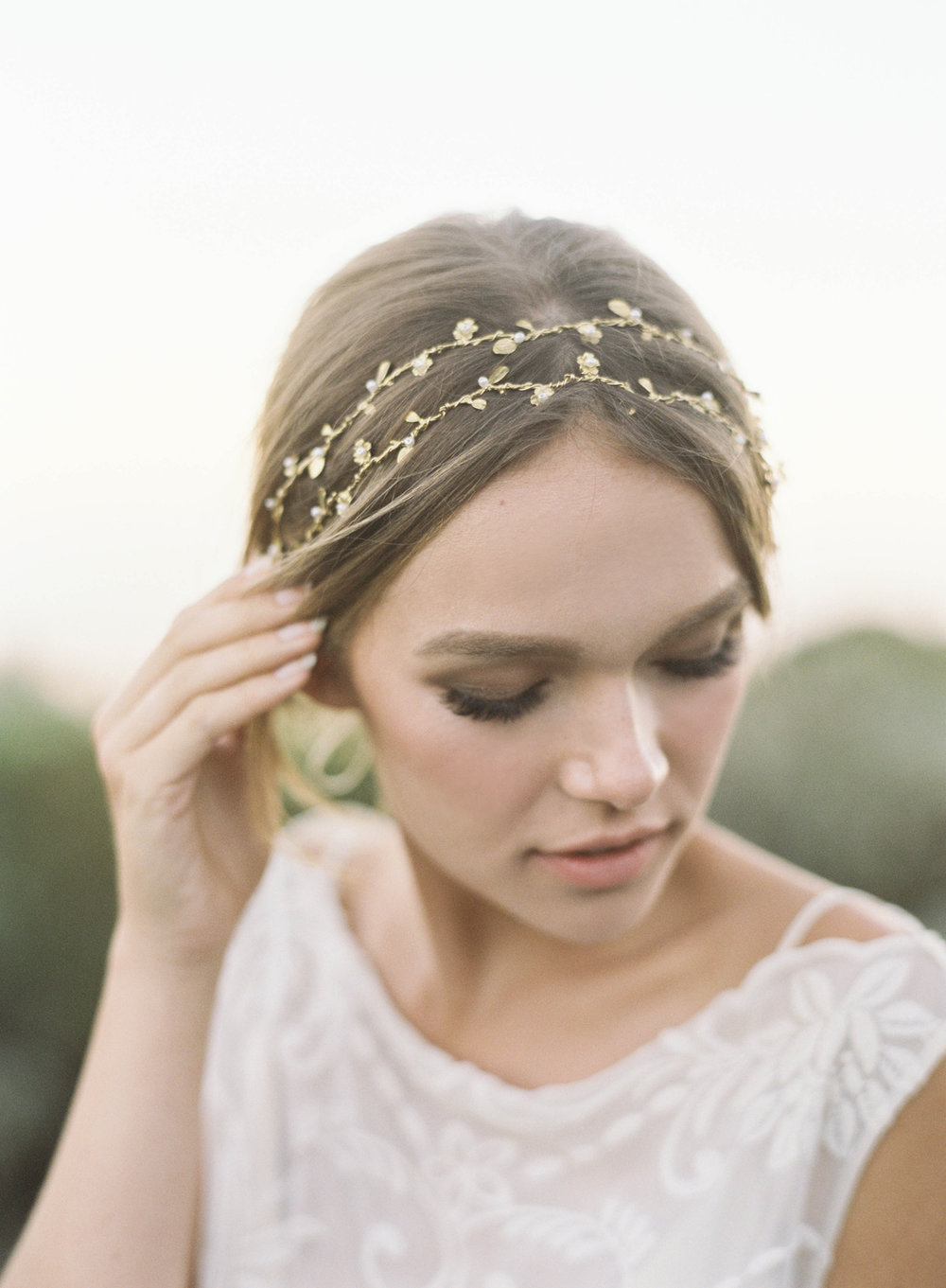Forever everyone's favorite hair vine,   Matilda   - subtly feminine and floral. Offered in gold, silver and rose gold with tiny pearl or crystal accents! Farm house wedding ready but also not too sweet for our city gals craving something floral!