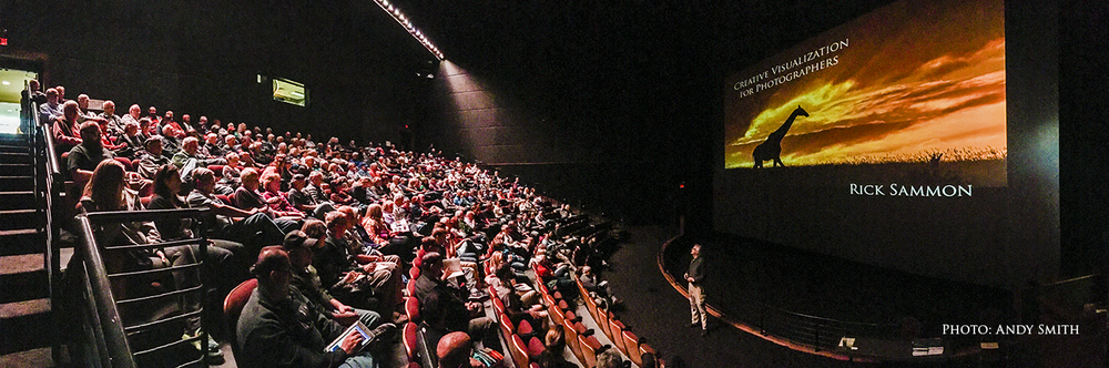 That's me at the Denver IMAX. My books are on stage at the bottom right of the photo.