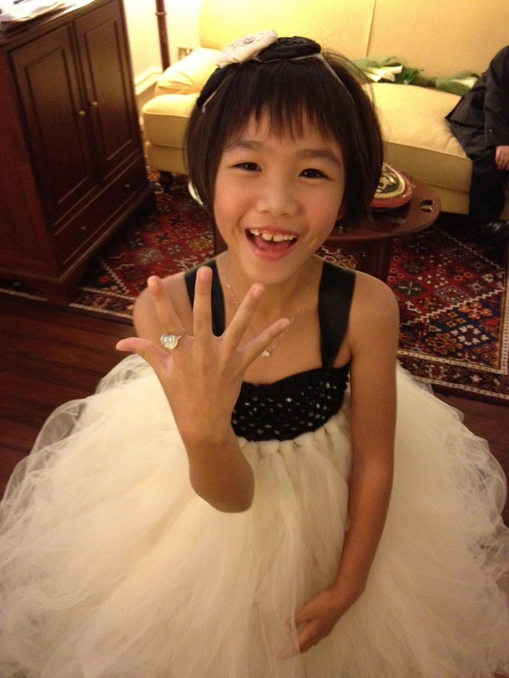 Our adorable flower girl showing off her own bling