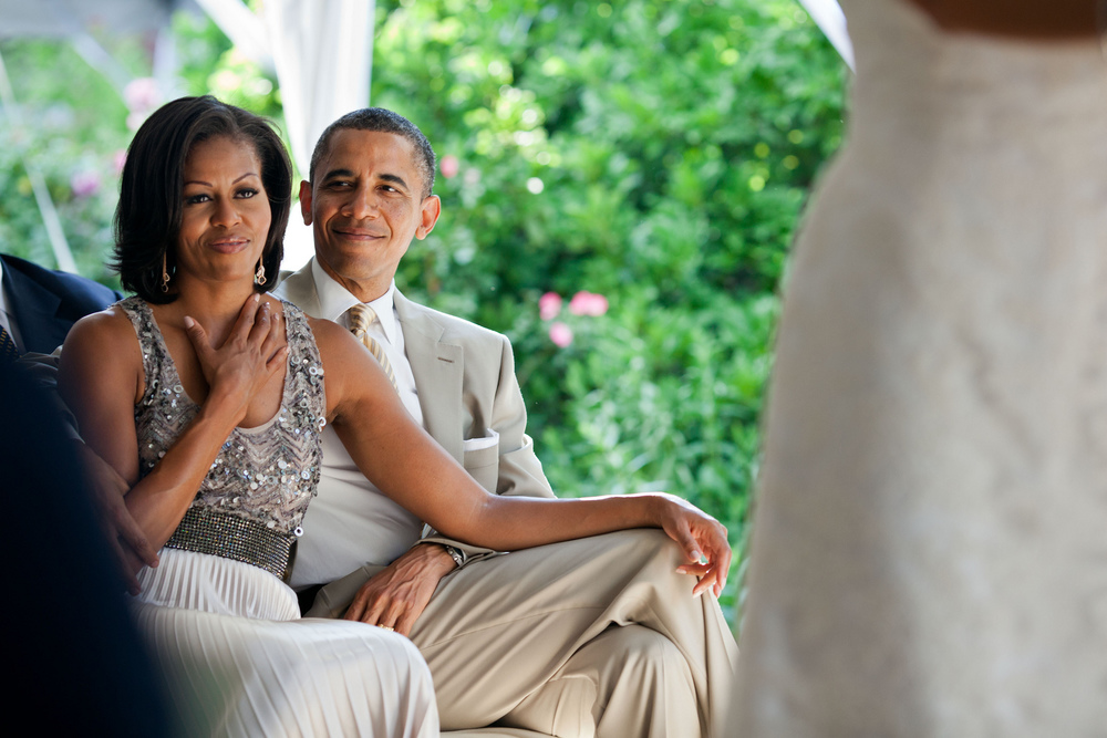 """June 18, 2012   """"The First Lady reacts as she watches Laura Jarrett and Tony Balkissoon take their vows during their wedding at Valerie Jarrett's home in Chicago."""" (Official White House Photo by Pete Souza)"""