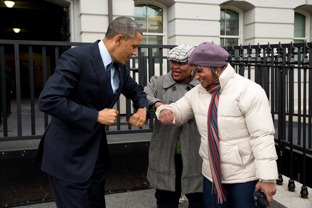 """Dec. 31, 2012 """"Following remarks in the Eisenhower Executive Office Building on the fiscal cliff negotiations, the President greets a couple of OMB workers as he walked back across on West Executive Avenue as he walked back to the West Wing of the White House. He gave them an elbow-bump, because he had just put Purell on his hands."""" (Official White House Photo by Pete Souza)"""